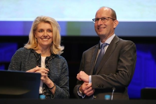 amp-ceo-craig-mellor-stands-on-stage-with-chairman-catherine-brenner-before-their-agm-in-sydney__724275_
